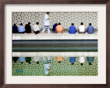 With the Water Reflection, a Muslim Man Walks Past Others Offering the Friday Prayer at a Mosque Framed Photographic Print