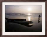 Fisherman Walks by a Tsunami Damaged Fishing Boat at a Fishermen's Colony in Cuddalore, India Framed Photographic Print