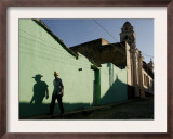 A Man Makes His Way Down Boca Street at the Historic Center of Trinidad Framed Photographic Print by Javier Galeano
