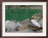 A Hindu Pilgrim Rests Along the Peaceful Bank of the Ganges River Near Rishikesh Framed Photographic Print