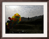 A Boy Walks as Selling Balloons in a Neighborhood in Kabul, Afghanistan, Thursday, August 24, 2006 Framed Photographic Print by Rodrigo Abd