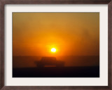 An American Humvee Drives Through the Desert at Sunset Near the Iraqi Border Framed Photographic Print