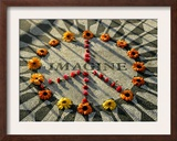 A Makeshift Peace Sign of Flowers Lies on Top John Lennon's Strawberry Fields Memorial Framed Photographic Print