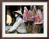 A Vietnamese Vendor Rides Downs a Hanoi City Street Selling Santa Hats Framed Photographic Print