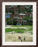 Venezuelan Children Play Soccer at the Resplandor Shantytown Framed Photographic Print