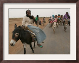 Sudanese Women Ride Donkeys at the Entrance of the Zamzam Refugee Camp Framed Photographic Print