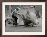A Tricycle Rider Transports His Passenger Framed Photographic Print