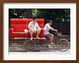A Chinese Man Rides on a Sofa as Another Pedals a Delivery Tricycle Framed Photographic Print