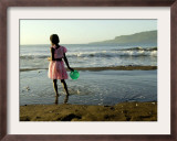 A Girl Walks on the Beach in Jacmel, Haiti, in This February 5, 2001 Framed Photographic Print by Lynne Sladky