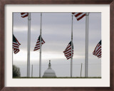 Flags at the Washington Monument Fly at Half Staff Framed Photographic Print by Gerald Herbert