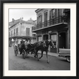 Tourists Take in the Scenery Via Horse-Drawn Carriage on Royal Street in New Orleans Framed Photographic Print