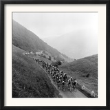 Contestants in the Grueling Tour De France are Seen on Their Way to the Mente Pass Framed Photographic Print