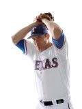 Texas Rangers Photo Day, SURPRISE, AZ - FEBRUARY 25: Colby Lewis Photographic Print by Jonathan Ferrey