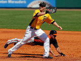 Baltimore Orioles v Pittsburgh Pirates, BRADENTON, FL - FEBRUARY 28: J.J. Hardy and Lyle Overbay Photographic Print by J. Meric