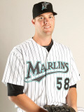 Florida Marlins Photo Day, JUPITER, FL - FEBRUARY 23: Ryan Webb Photographic Print by Mike Ehrmann