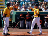 Baltimore Orioles v Pittsburgh Pirates, BRADENTON, FL - FEBRUARY 28: Lyle Overbay and Garrett Jones Photographic Print by J. Meric
