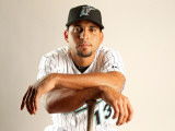 Florida Marlins Photo Day, JUPITER, FL - FEBRUARY 23: Omar Infante Photographic Print by Mike Ehrmann