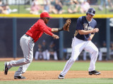 Los Angeles Angels of Anaheim v San Diego Padres, PEORIA, AZ - MARCH 15: Erick Aybar and Brad Hawpe Photographic Print by Christian Petersen