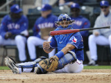 Kansas City Royals v Texas Rangers, SURPISE, AZ - FEBRUARY 27: Yorvit Torrealba Photographic Print by Rob Tringali