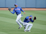 Texas Rangers v Seattle Mariners, PEORIA, AZ - MARCH 01: Engel Beltre and Andres Blanco Photographic Print by Harry How