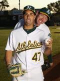 Oakland Athletics Photo Day, PHOENIX, AZ - FEBRUARY 24: Geio Gonzalez and Brad Ziegler Photographic Print by Ezra Shaw