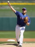 Cincinnati Reds v Texas Rangers, SURPRISE, AZ - MARCH 11: Colby Lewis Photographic Print by Christian Petersen