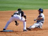New York Mets v Florida Marlins, JUPITER, FL - MARCH 04: Chris Coghlan and Nick Evans Photographic Print by Marc Serota
