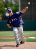 Texas Rangers v Los Angeles Dodgers, GLENDALE, AZ - MARCH 15: Derek Holland Photographic Print by Kevork Djansezian