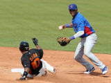 Chicago Cubs v San Francisco Giants, SCOTTSDALE, AZ - MARCH 01: Starlin Castro and Miguel Tejada Photographic Print by Christian Petersen