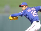 Kansas City Royals v Texas Rangers, SURPISE, AZ - FEBRUARY 27: Yoshinori Tateyama Photographic Print by Rob Tringali
