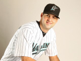 Florida Marlins Photo Day, JUPITER, FL - FEBRUARY 23: Burke Badenhop Photographic Print by Mike Ehrmann