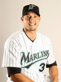 Florida Marlins Photo Day, JUPITER, FL - FEBRUARY 23: Clay Hensley Photographic Print by Mike Ehrmann