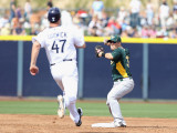 Oakland Athletics v San Diego Padres, PEORIA, AZ - MARCH 06: Cliff Pennington and Ryan Ludwick Photographic Print by Christian Petersen