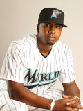 Florida Marlins Photo Day, JUPITER, FL - FEBRUARY 23: Ruben Gotay Photographic Print by Mike Ehrmann