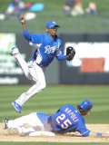 Kansas City Royals v Texas Rangers, SURPISE, AZ - FEBRUARY 27: Alcides Escobar and Mike Napoli Photographic Print by Rob Tringali