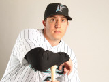 Florida Marlins Photo Day, JUPITER, FL - FEBRUARY 23: John Raynor Photographic Print by Mike Ehrmann