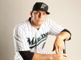 Florida Marlins Photo Day, JUPITER, FL - FEBRUARY 23: Logan Morrison Photographic Print by Mike Ehrmann