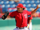 Florida Marlins v Washington Nationals, VIERA, FL - MARCH 02: John Lannan Photographic Print by Mike Ehrmann