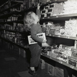 Toddler in Candy Aisle of Store Photographic Print by H. Armstrong Roberts