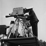 Local Television Station Camera Crew Outdoors on Platform, Filming Fotografisk tryk af H. Armstrong Roberts