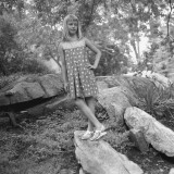 Girl (12-13) Standing on Boulder in Forest Photographic Print by George Marks