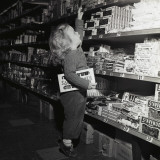 Toddler in Candy Aisle of Supermarket Photographic Print by H. Armstrong Roberts
