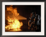 Firefighters Extinguishing a Simulated Battery Fire Posters by  Stocktrek Images