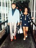 Elizabeth Taylor with Richard Burton Arriving at Heathrow Airport, June 1977 Photographic Print