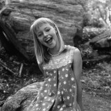 Girl (12-13) Sitting on Boulder, Portrait Photographic Print by George Marks