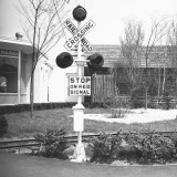 Railroad Crossing Stop Sign and Warning Light Photographic Print by George Marks