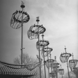 Decorations on Poles Photographic Print by George Marks