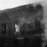 Firemen on Fire Escape, at Top Floor of Burning Apartment Building Fotografisk tryk af H. Armstrong Roberts