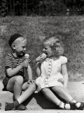 Boy and Girl Sitting on Curb, Eating Ice Cream Cones Photographic Print by H. Armstrong Roberts