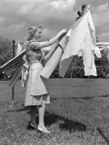 Woman, Housewife, is Outdoors, Hanging Clean Fresh Laundry on Clothesline Photographic Print by H. Armstrong Roberts
